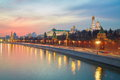 A river tram that sails along the walls of the Moscow Kremlin on a winter evening at sunset