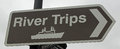 River trips brown tourist sign denoting symbolizing tourism summer vacations and holidays Stock Image