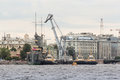 River tugboats and the crane near the cruiser Royalty Free Stock Photo