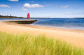 River tyne beach at south shields the groyne lighthouse sits in the mouth of the to protect the and help with navigation Royalty Free Stock Images