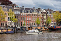 River view of amsterdam houses and houseboats on the amstel in netherlands north holland province Royalty Free Stock Photography