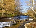 River and waterfalls flowing over rocks small near abergavenny wales Royalty Free Stock Photography