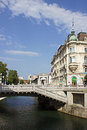 Riverbank on ljubljanica river and triple bridge Royalty Free Stock Photography