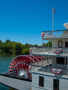 Riverboat paddle wheel in a river red with trees Royalty Free Stock Images