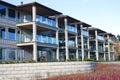 Riverfront condominiums. Royalty Free Stock Photos