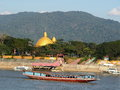 Riverscape tourist boats and business scene over MEKONG river, at GOLDEN TRIANGLE