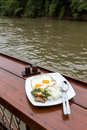 Riverside breakfast with thai food yummy at Royalty Free Stock Photo