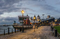 Riverside cobbled footpath at twilight in the historic liverpool s dock district blured people in motion Royalty Free Stock Photography