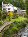 Riverside country hotel with garden a house and guest house on the banks of a river gwynedd wales uk Stock Photo