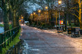 Riverside footpath at night lined with trees and benches in inverness scotland Stock Photo