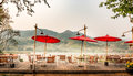 Riverside Mekong river restaurant in chiang rai ,Thailand in summer It`s very hot . Royalty Free Stock Photo