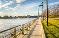 Riverside path at sunset paved on a pier hudson river park in new york Stock Photo