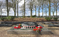 The riverthames in england langermark german ww war cemetery flanders belgium with poppy wreaths and wooden remembrance crosses Royalty Free Stock Photography