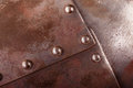 Rivets close up shot of an iron armour plate with Stock Photo