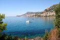 The riviera view of beautiful french from cap martin west towards monaco boats idle at anchor in clear blue mediterranean Stock Images