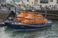 Rnli lifeboats falmouth in the harbour during the falmouth tall ships regatta cornwall england th august Royalty Free Stock Photo