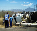 Road accident a truck tipped over to its side on the highway Royalty Free Stock Photography