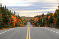 Road through Algonquin Provincial Park in fall, Ontario, Canada Royalty Free Stock Photo
