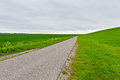 Road along dam asphalt protective in the netherlands Royalty Free Stock Photos