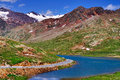 Road along lake lago bianco near top famous gavia high mountain pass italy Royalty Free Stock Image
