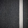 Road asphalt with white solid line Royalty Free Stock Photos