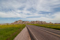 Road through the badlands a open country leads into awesome mountain formations in national park south dakota Royalty Free Stock Photos