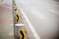 Road barriers beside the crosswalk Stock Photography