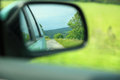 Road car rear view mirror motion blur background on the with and Stock Image