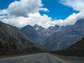 Road in chile a typical and cordillera de los andes mountains Royalty Free Stock Images