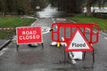 Road closed and flood sign due to heavy rain floods Stock Photos