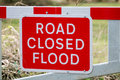 Flood Road Closed Warning Sign on Barrier Royalty Free Stock Photo