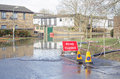 Road closed by flooding basingstoke england february a residential in hampshire rising flood waters after many days of heavy Stock Images