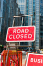 Road closed sign close up of the red on the street of city center Royalty Free Stock Photos