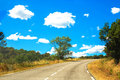 Road and clouds. Travel concept. Royalty Free Stock Photo