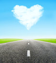 Road and cloudy heart in sky Royalty Free Stock Photo