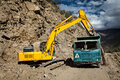 Road construction in mountains himalayas excavator and truck lahaul valley himachal pradesh india Stock Images