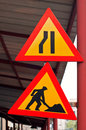 Road construction traffic signs under and constriction isolated Royalty Free Stock Image