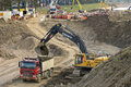 Road construction with truck and excavator netherlands gelderlland province roadworks near the village heumen an loads a earth Stock Photos