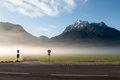 Road covered with fog with a view of mountain Royalty Free Stock Photo