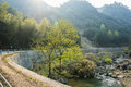 Road curves and brook the along the stream this photo was taken in nanxi river scenic area yongjia county zhejiang province china Stock Photos