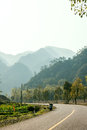 Road curves in the valley this photo was taken in nanxi river scenic area yongjia county zhejiang province china Royalty Free Stock Image