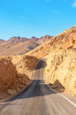 The road in death valley under blue sky Royalty Free Stock Photo