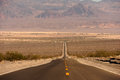 Road into death valley ws the usa from the california side morning light pink light on the hills near stovepipe wells Stock Photos