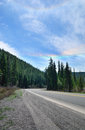 Road in deep forest. Iridescent rings in the sky. Royalty Free Stock Photos