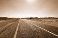 Road in the desert fragment of sepia Royalty Free Stock Photography