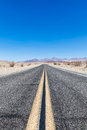 Road in the desert prospective middle of death valley usa Royalty Free Stock Photos