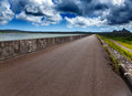 The road on an embankment at a reservoir of fresh water mauritius Royalty Free Stock Photography