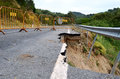 Road erosion collapse due to Stock Images