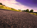 Road in evening time a with violet cloudy sky Stock Images