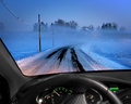 Road in fog rural cold foggy winter evening seen through windscreen of car Stock Image